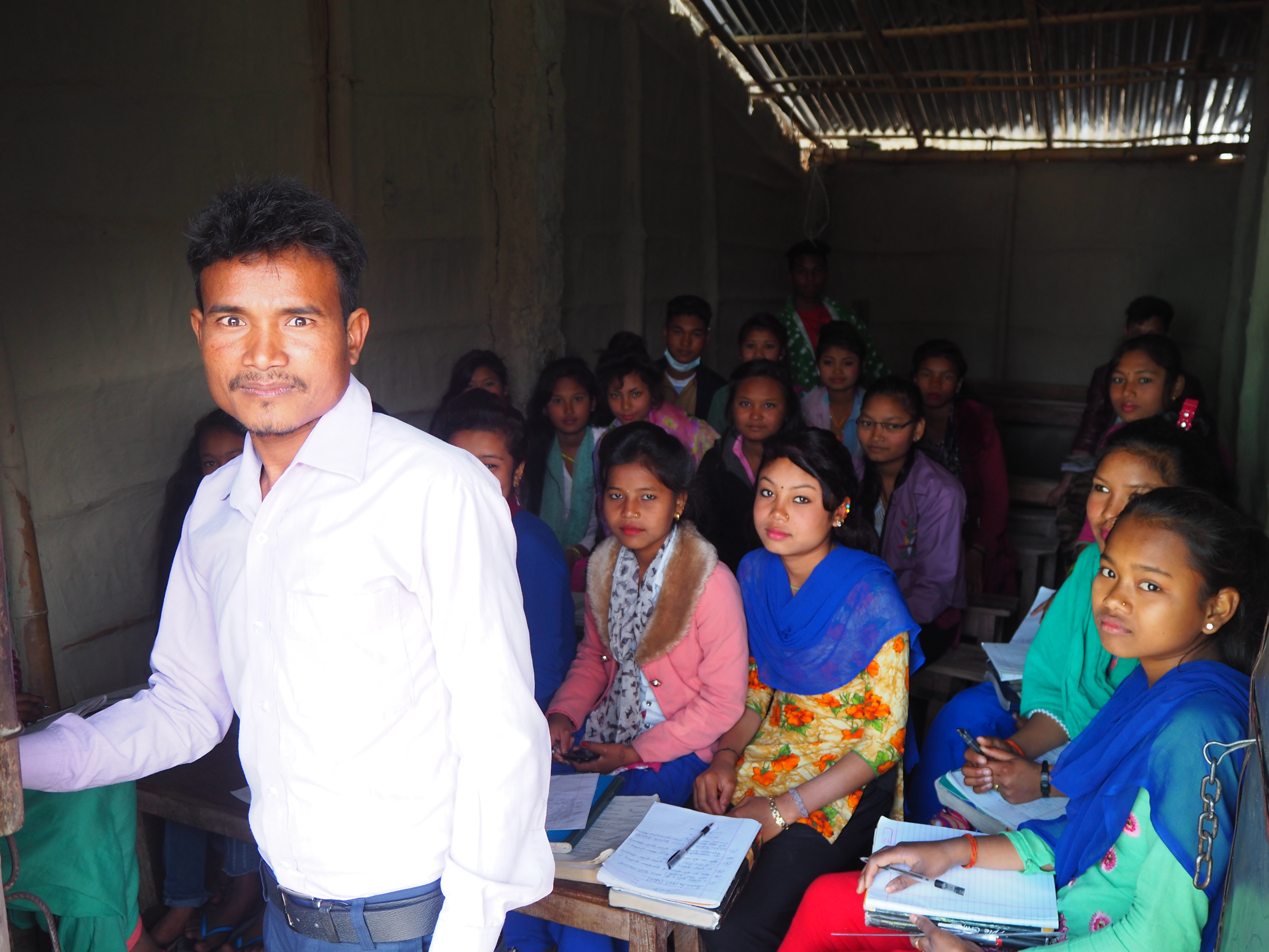 Tuition class in Rajapur, taught by tutor Sukh Ram Chaudhary, 31. Pramila Tharu attended Chaudhary's class before she died. Credit: Peter Gill