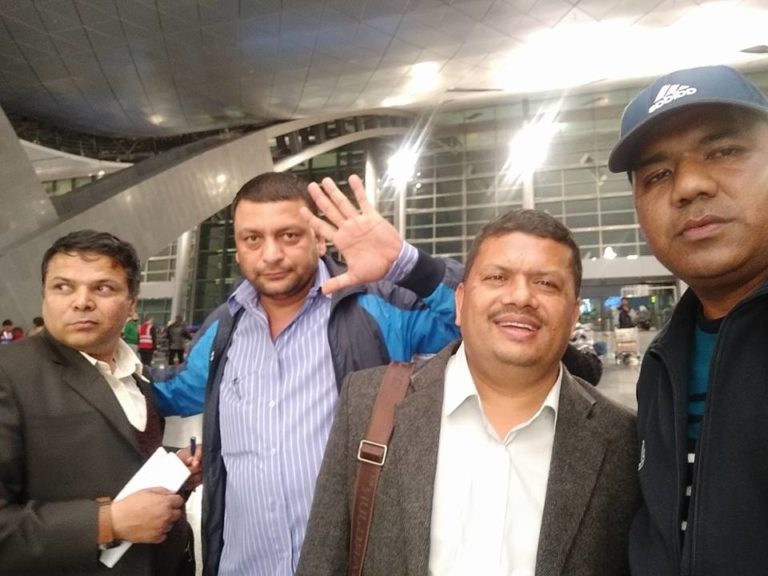 Waving Doha goodbye. Archaya on the extreme left and Bista on the extreme right just before flying back to Nepal. Photo: Ramesh Bista/Facebook