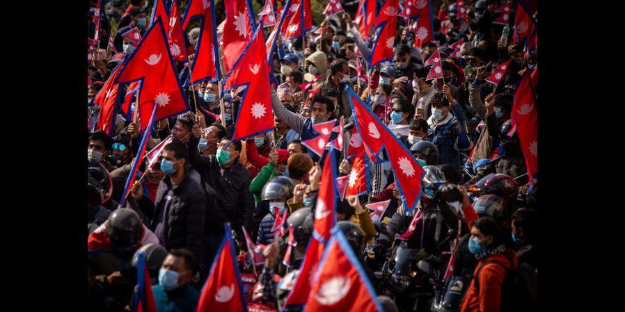 Protestors walk towards the federal parliament building chanting pro monarchy slogans, in Kathmandu, on December 5, 2020. Photo: Nishant S.Gurung/Zenger News